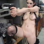 Nude girl with pistol